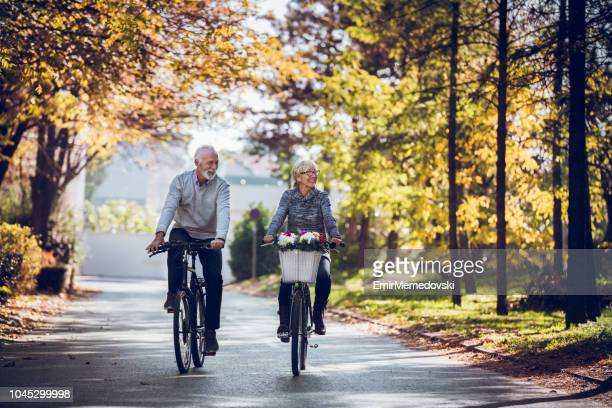 keeping the body strong with regular bicycle rides - senior adult stock pictures, royalty-free photos & images