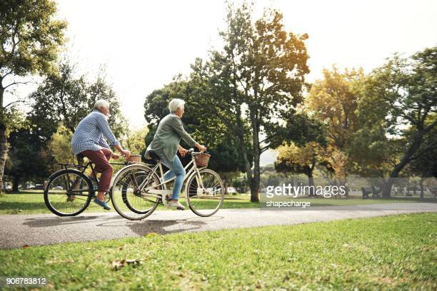 keeping the body strong with regular bicycle rides - bicycle stock pictures, royalty-free photos & images