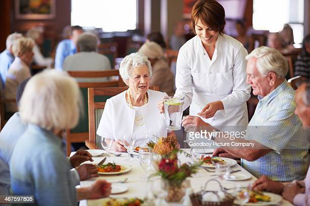 keeping the elderly happy - dining room stock pictures, royalty-free photos & images