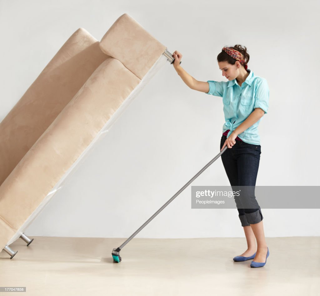 Keeping the house clean takes super strength! : Stock Photo