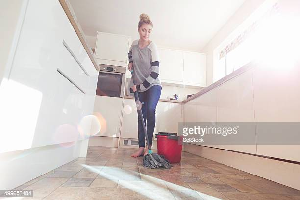 keeping the kitchen sparkling clean - flooring stock photos and pictures