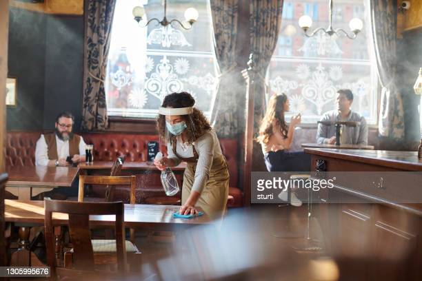 keeping the pub covid safe - hygiene stock pictures, royalty-free photos & images