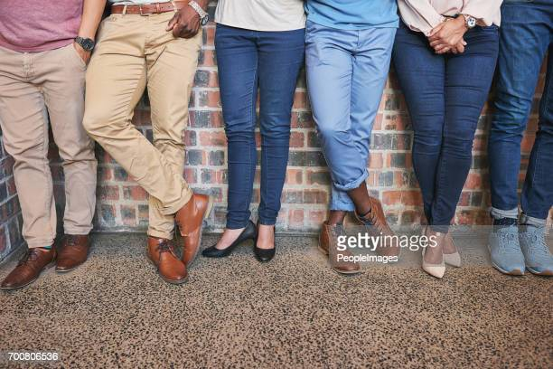 keeping their feet firmly on the ground - work shoe stock photos and pictures
