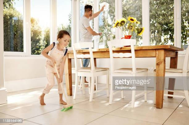 keeping their home extra clean - sweeping stock pictures, royalty-free photos & images