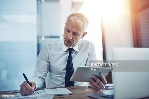 keeping track of facts and figures - time management stock photos and pictures
