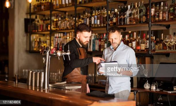keeping track of the stock - bartender stock pictures, royalty-free photos & images