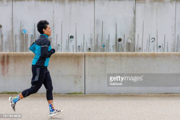 keeping up her fitness - menopossibilities stock pictures, royalty-free photos & images
