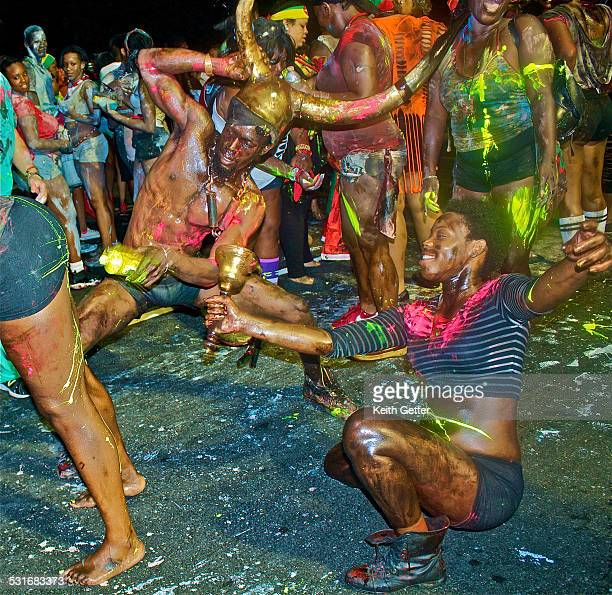 Keeping Up The Culture of Trinidad at the West Indian American Day J'Ouvert Carnival in Crown Heights Brooklyn NYC USA the 'Jab Jabs' smear mud paint...
