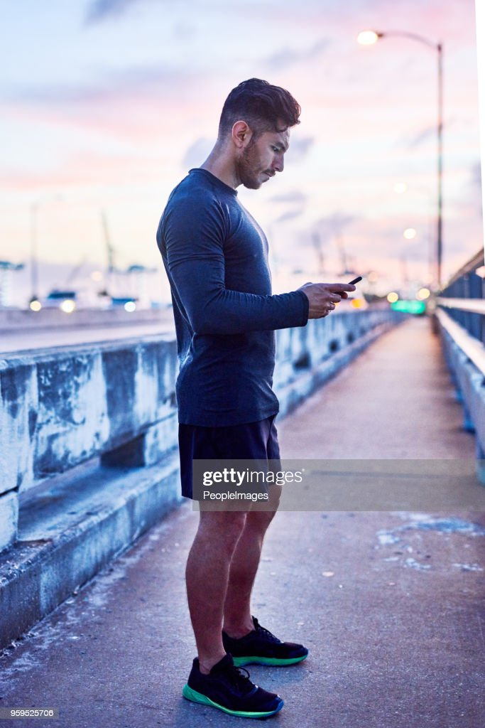 Keeping up with his communications while out and about : Stock Photo