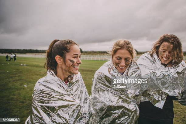 keeping warm after the race - the end stock pictures, royalty-free photos & images