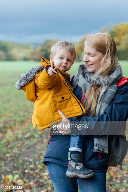 keeping warm in autumn - babyhood stock pictures, royalty-free photos & images