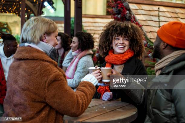 keeping warm with hot chocolate - honour stock pictures, royalty-free photos & images