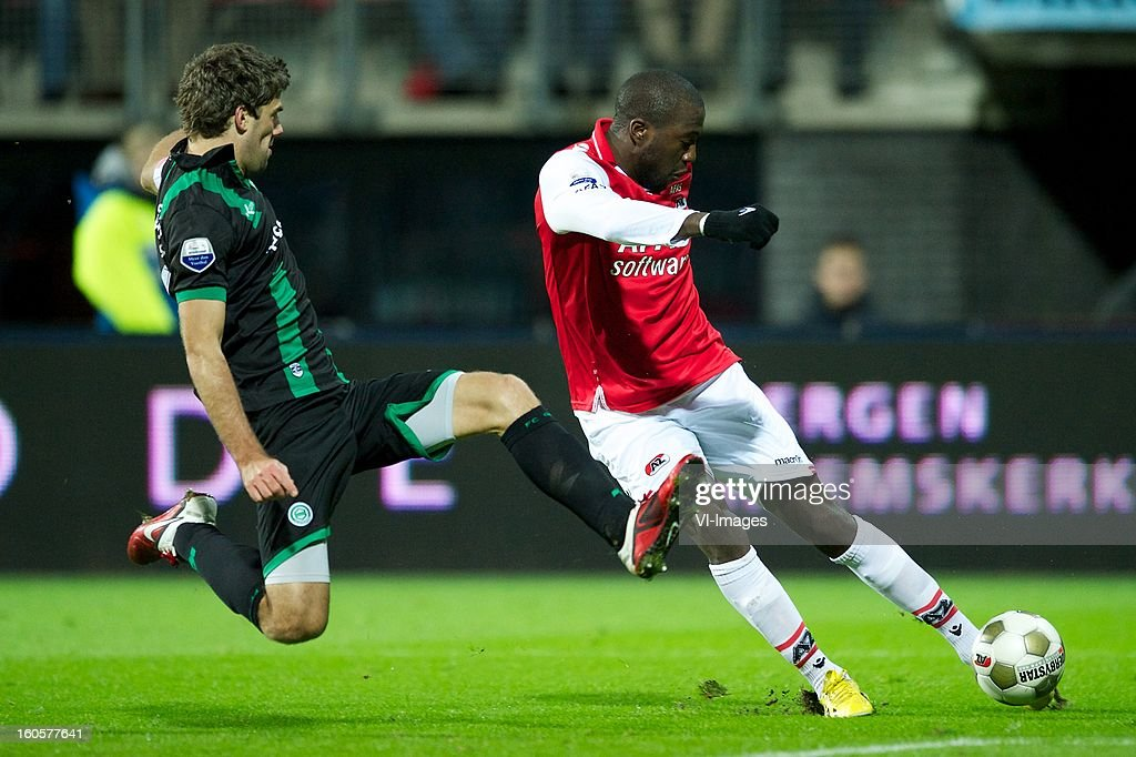 Kees Kwakman of FC Groningen, Jozy Altidore of AZ during the Dutch Eredivisie match between AZ Alkmaar and FC Groningen at the AFAS Stadium on february 2, 2013 in Alkmaar, The Netherlands