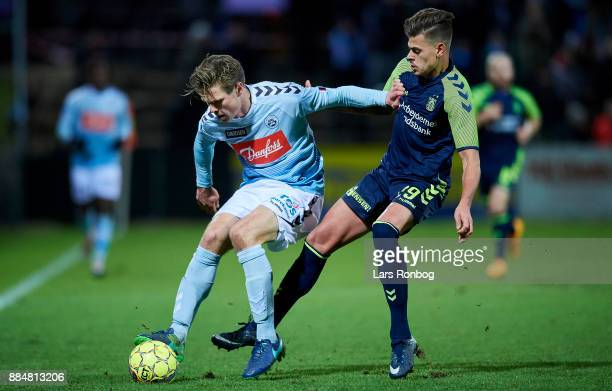 Kees Luijckx of Sonderjyske and Jan Kliment of Brondby IF compete for the ball during the Danish Alka Superliga match between Sonderjyske and Brondby...