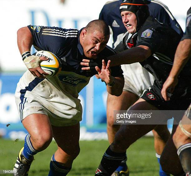 Kees Meeuws of the Blues gets past Adri Badenhorst of the Stormers during the Super 12 match between the Stormers and The Blues April 19, 2003 at...