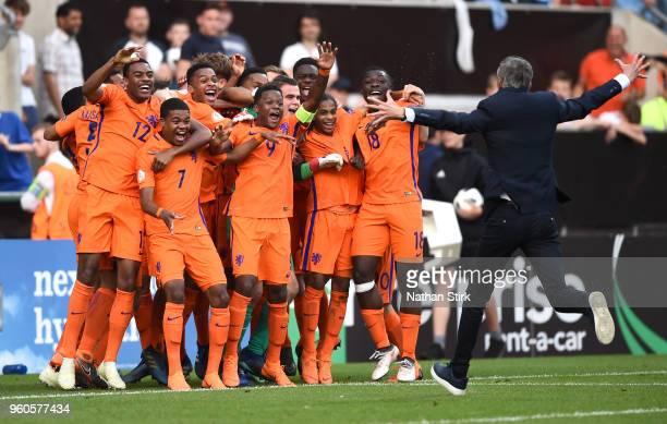 Kees Van Wonderen manager of the Netherlands runs to his players to celebrate winning after the UEFA European Under17 Championship Final between...