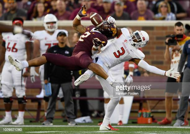 KeeSean Johnson of the Fresno State Bulldogs breaks up an interception by Jacob Huff of the Minnesota Golden Gophers during the second quarter of the...