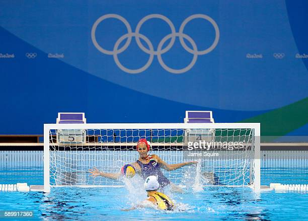 Keesja Gofers of Australia shoots a penalty shot as Orsolya Kaso of Hungary during their Women's Water Polo quarterfinal match at the Rio 2016...