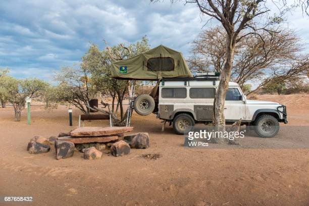 Keetmanshoop Namibia Africa Land Rover with rooftent parked at a campsite