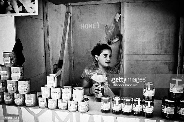 Kefalos village Kos island Greece Young woman selling local honey