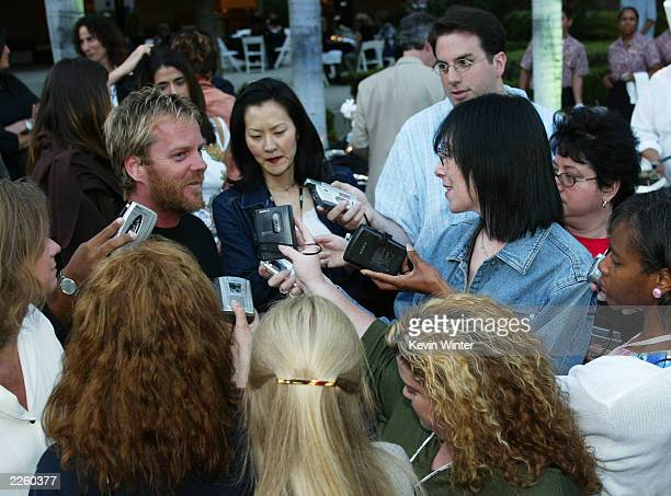 Kefer Sutherland star of the Fox series 24 is surrounded by the press at the FOX 2002 SummerTCA Tour at the Huntington Ritz Carlton Hotel in Pasadena...