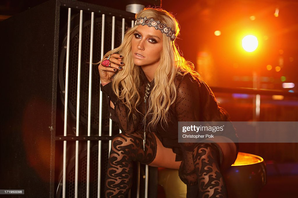 Ke$ha poses in the Wonderwall Portrait Studio at the iHeartRadio Ultimate Pool Party Presented by VISIT FLORIDA at Fontainebleau's BleauLive in Miami featuring live performances by Pitbull, Ke$ha, Afrojack, Icona Pop, Krewella and Jason Derulo on June 29, 2013 in Miami Beach, Florida.