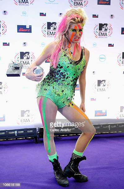 Ke$ha poses with her Best New Act Award in front of the media boards at the MTV Europe Music Awards 2010 at La Caja Magica on November 7 2010 in...