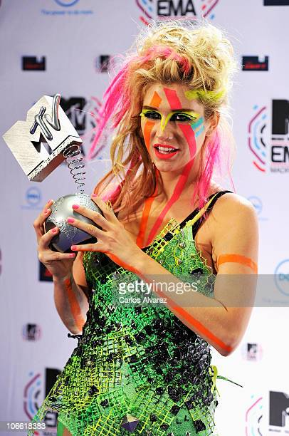 Ke$ha poses with the Best New Act Award in front of the media boards at the MTV Europe Music Awards 2010 at La Caja Magica on November 7 2010 in...