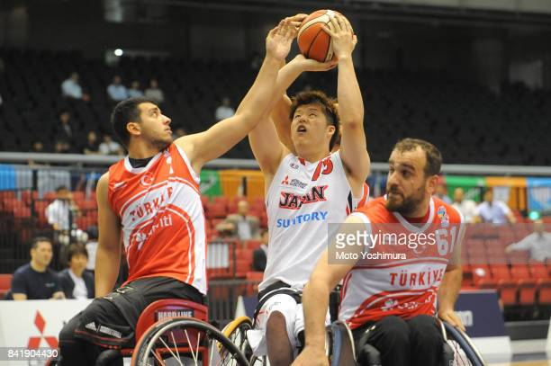 Kei Akita of Japan competes for the ball during the Wheelchair Basketball World Challenge Cup match between Japan and Turkey at the Tokyo...
