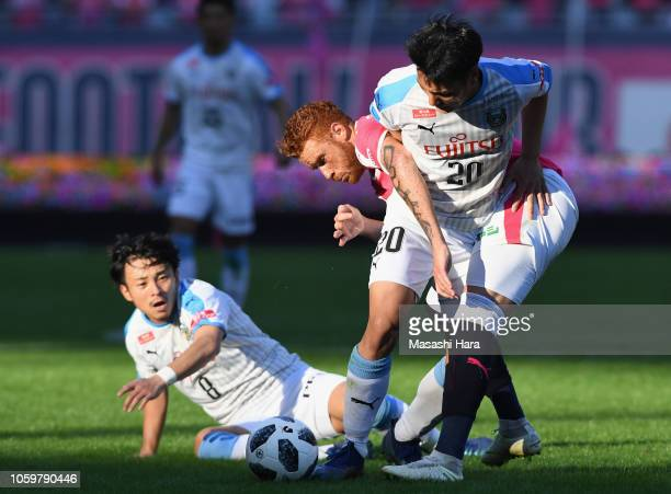 Kei Chinen of Kawasaki Frontale and Souza of Cerezo Osaka compete for the ball during the JLeague J1 match between Cerezo Osaka and Kawasaki Frontale...