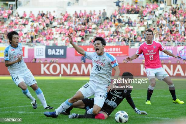 Kei Chinen of Kawasaki Frontale is brought down by Kim Jin Hyeon of Cerezo Osaka in the box resulting in a penalty kick during the JLeague J1 match...
