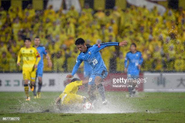 Kei Chinen of Kawasaki Frontale is tackled during the J.League J1 match between Kashiwa Reysol and Kawasaki Frontale at Hitachi Kashiwa Soccer...