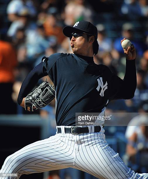 Kei Igawa of the New York Yankees delivers a pitch during a Grapefruit League Spring Training Game against the Minnesota Twins at George M...