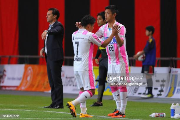 Kei Ikeda of Sagan Tosu is brought in for Hiroki Kawano during the JLeague J1 match between Consadole Sapporo and Sagan Tosu at Sapporo Dome on...