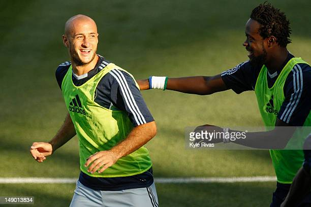 Kei Kamara and Aurelien Collin of the Sporting KC warm up before the game against the New England Revolution at Livestrong Sporting Park on July 21...