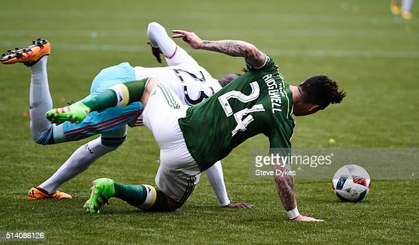Kei Kamara of Columbus Crew and Liam Ridgewell of Portland Timbers go after a ball during the second half of the game at Providence Park on March 6...