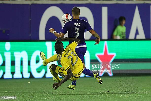Kei Kamara of Columbus Crew SC and Seb Hines of Orlando City SC fight for a ball during a MLS soccer match between the Columbus Crew SC and the...