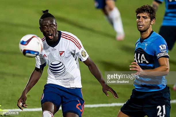 Kei Kamara of MLS AllStars works against Federico Fazio of Tottenham Hotspur during the 2015 ATT Major League Soccer AllStar game at Dick's Sporting...