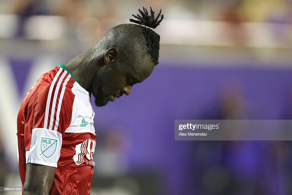 Kei Kamara #13 of New England Revolution is seen with his head down during a MLS soccer match at Camping World Stadium on July 31, 2016 in Orlando, Florida.