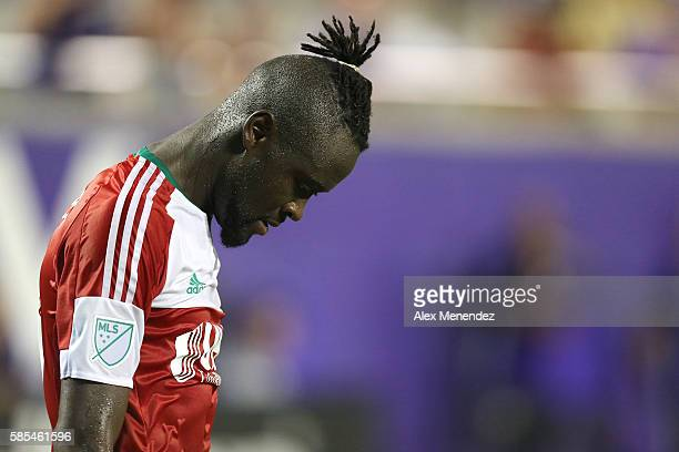 Kei Kamara of New England Revolution is seen with his head down during a MLS soccer match at Camping World Stadium on July 31 2016 in Orlando Florida
