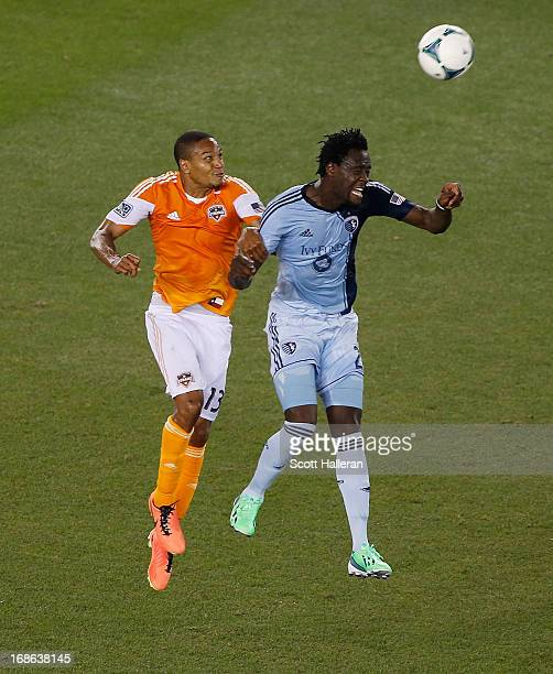 Kei Kamara of Sporting Kansas City fights for the ball against Ricardo Clark of the Houston Dynamo in the second half at BBVA Compass Stadium on May...