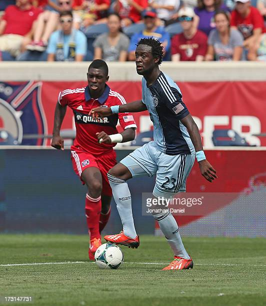 Kei Kamara of Sporting Kansas City looks to pass as Jalil Anibaba of the Chicago Fire closes in during an MLS match at Toyota Park on July 7 2013 in...