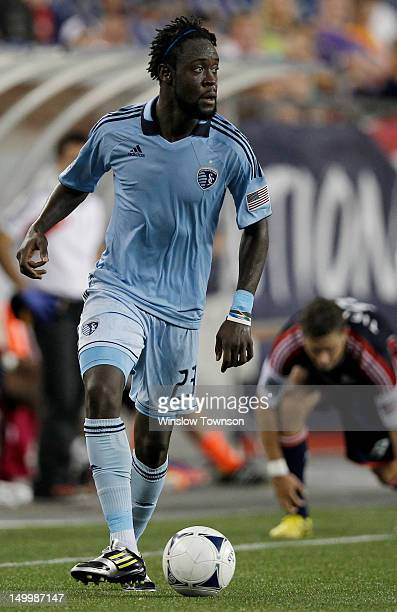 Kei Kamara of Sporting KC carries the ball during the second half against the New England Revolution at Gillette Stadium on August 4 2012 in Foxboro...