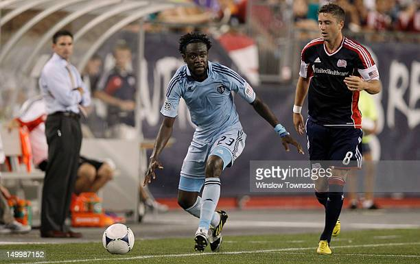 Kei Kamara of Sporting KC moves past Chris Tierney of New England Revolution during the second half at Gillette Stadium on August 4 2012 in Foxboro...