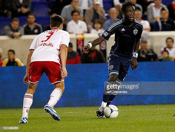 Kei Kamara of Sporting KC plays against Heath Pearce of New York Red Bulls during their match at Red Bull Arena on September 19, 2012 in Harrison,...