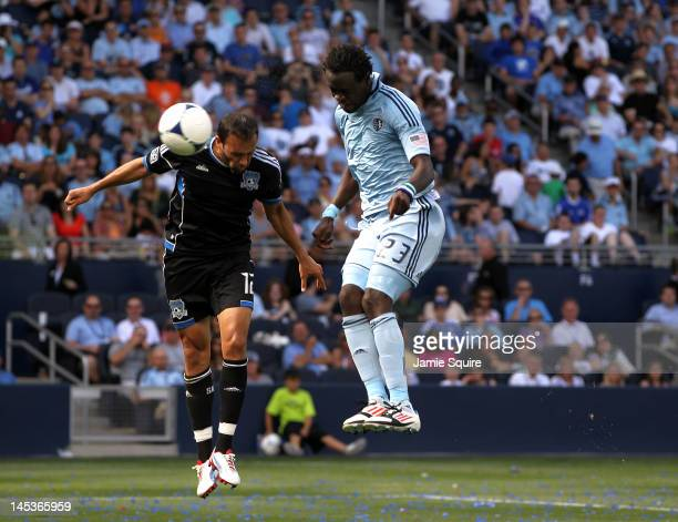 Kei Kamara of Sporting KC scores a header goal as Ramiro Corrales of the San Jose Earthquakes defends during the game on May 27 2012 at Livestrong...