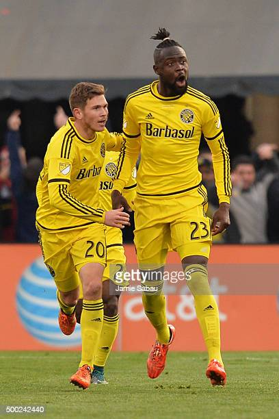 Kei Kamara of the Columbus Crew SC celebrates with Will Trapp after scoring a firsthalf goal against the Portland Timbers on December 6 2015 at...
