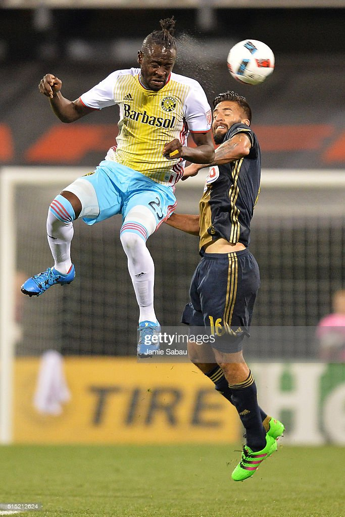 Kei Kamara #23 of the Columbus Crew SC heads the ball away from Richie Marquez #16 of the Philadelphia Union in the first half on March 12, 2016 at MAPFRE Stadium in Columbus, Ohio.