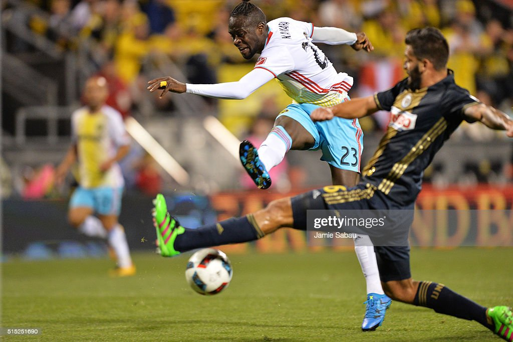 Kei Kamara #23 of the Columbus Crew SC launches a shot to the net past the defense of Richie Marquez #16 of the Philadelphia Union in the second half on March 12, 2016 at MAPFRE Stadium in Columbus, Ohio. Philadelphia defeated Columbus 2-1.