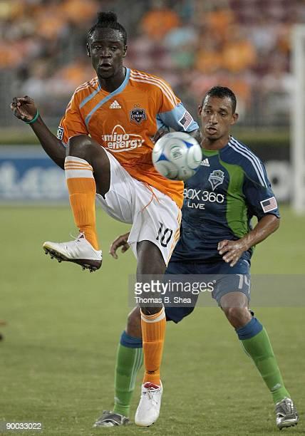 Kei Kamara of the Houston Dynamo kicks the ball against Tyrone Marshall of the Seattle Sounders FC at Robertson Stadium on August 23 2009 in Houston...